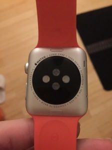 The underside of the Apple Watch Sport. Note different color band.